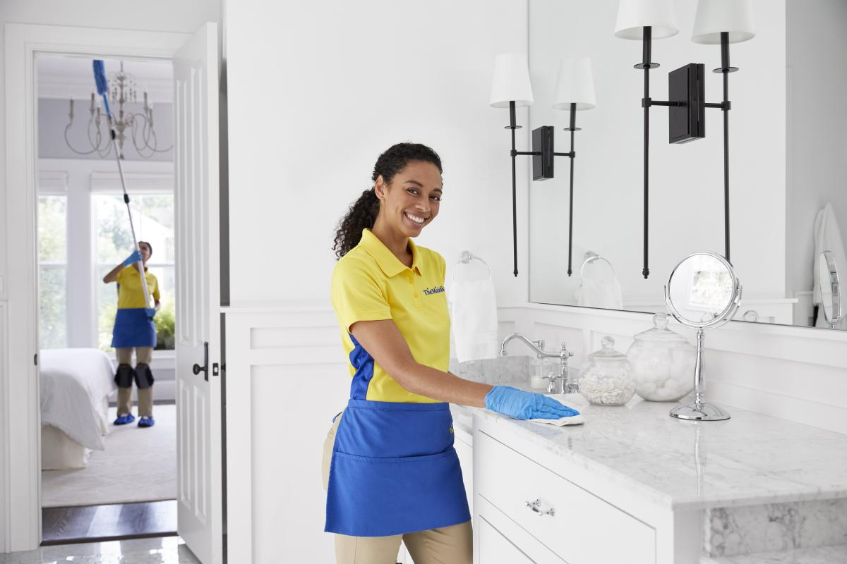 Maids cleaning bathroom sink