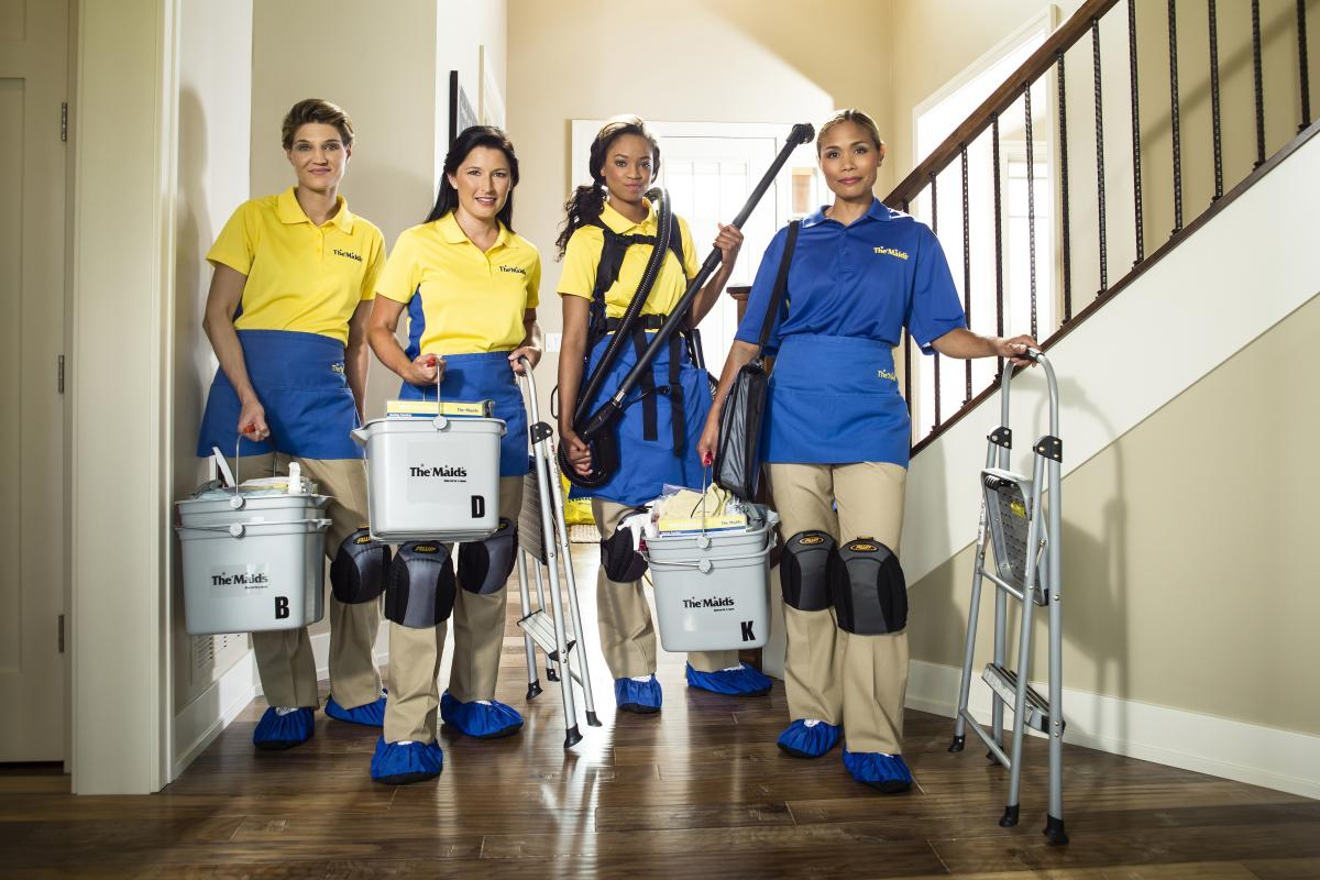 Maids employees standing in entryway